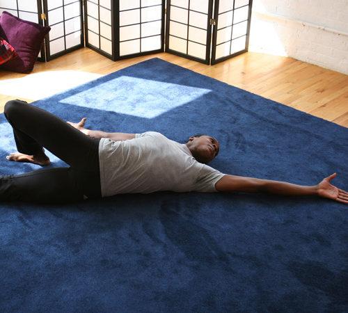 What is the feldenkrais method - man stretching on the floor