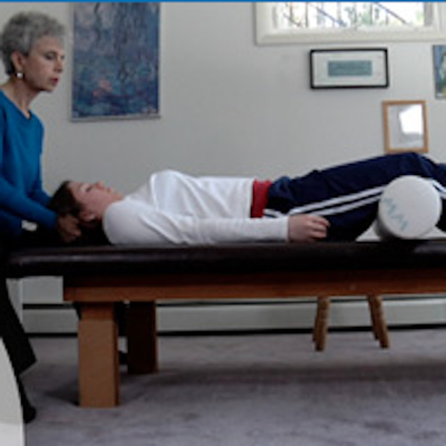 Feldenkrais Classes - student on table - aches and pains - child with special needs - vitality, mobility, and stability in aging - brain trauma